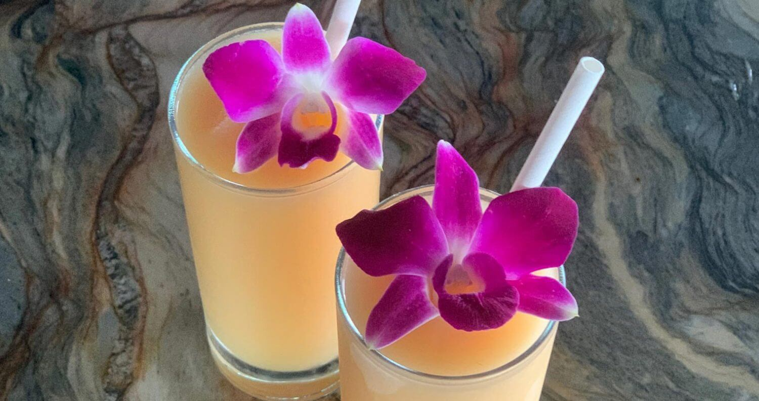 Tropic Like It's Hot, cocktails with edible purple flower garnish, featured image