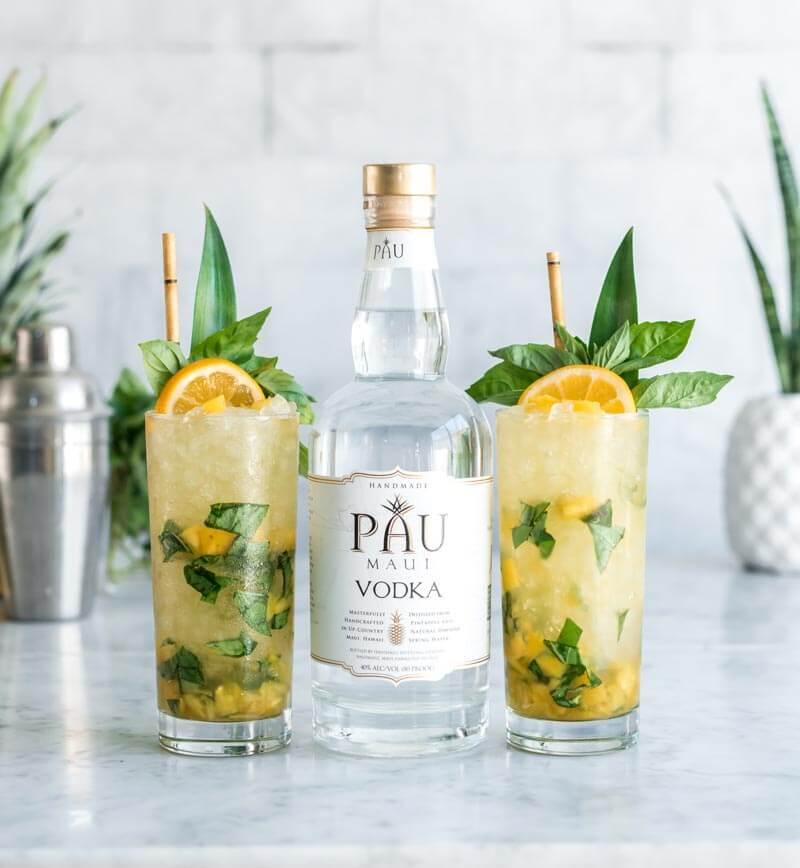 Vodka Pineapple Basil Smash, cocktails with bottle on marble top