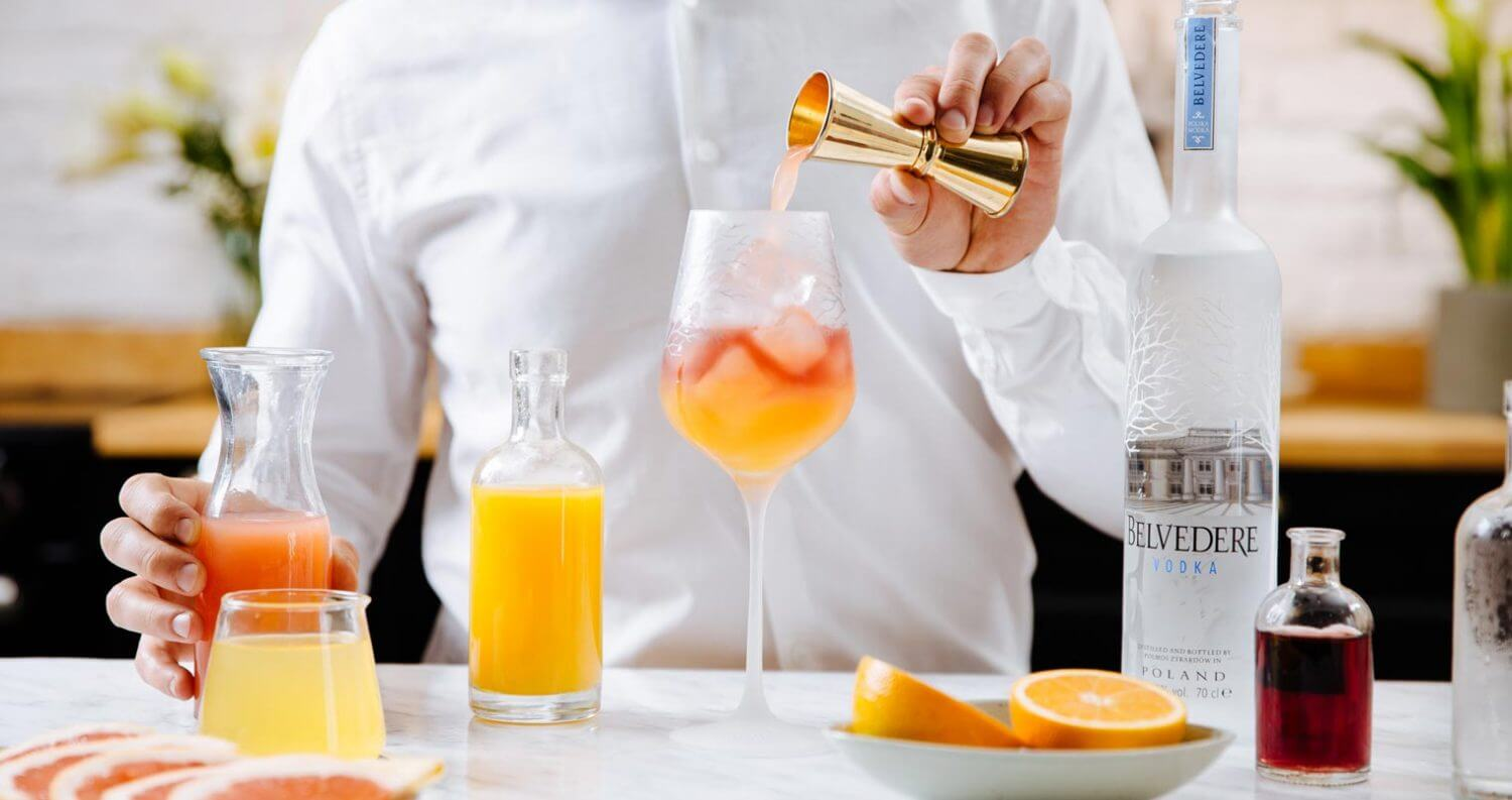 Belvedere Brunch Cocktails, mixologist mixing in chef kitchen, featured image