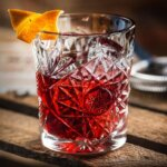The Perfect Negroni, cocktail with garnish, wooden table, featured image