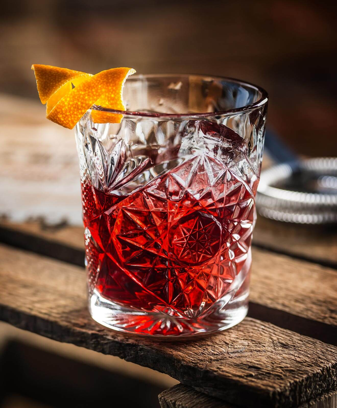 The Perfect Negroni, cocktail with garnish, wooden table
