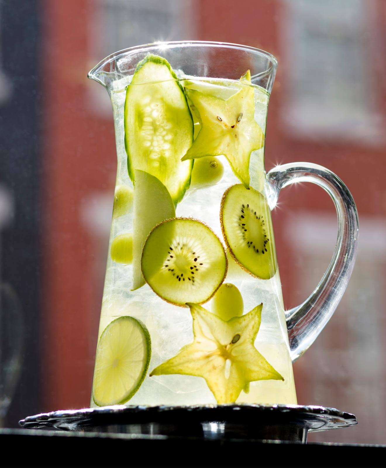 Al Fresco Spritz in pitcher with starfruit and kiwi