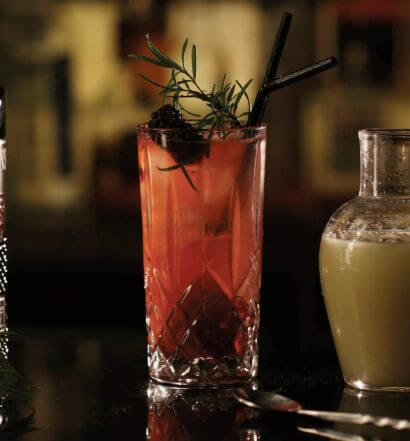 Blackberry Sling, brockmans bottle, garnishes and bar tools, featured image