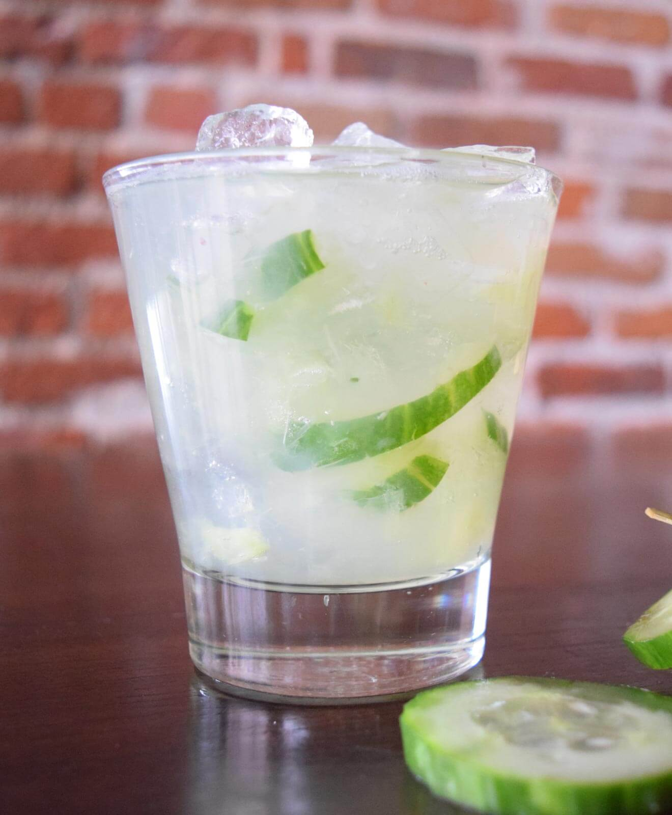 Cucumber Fresca cocktail, brick wall