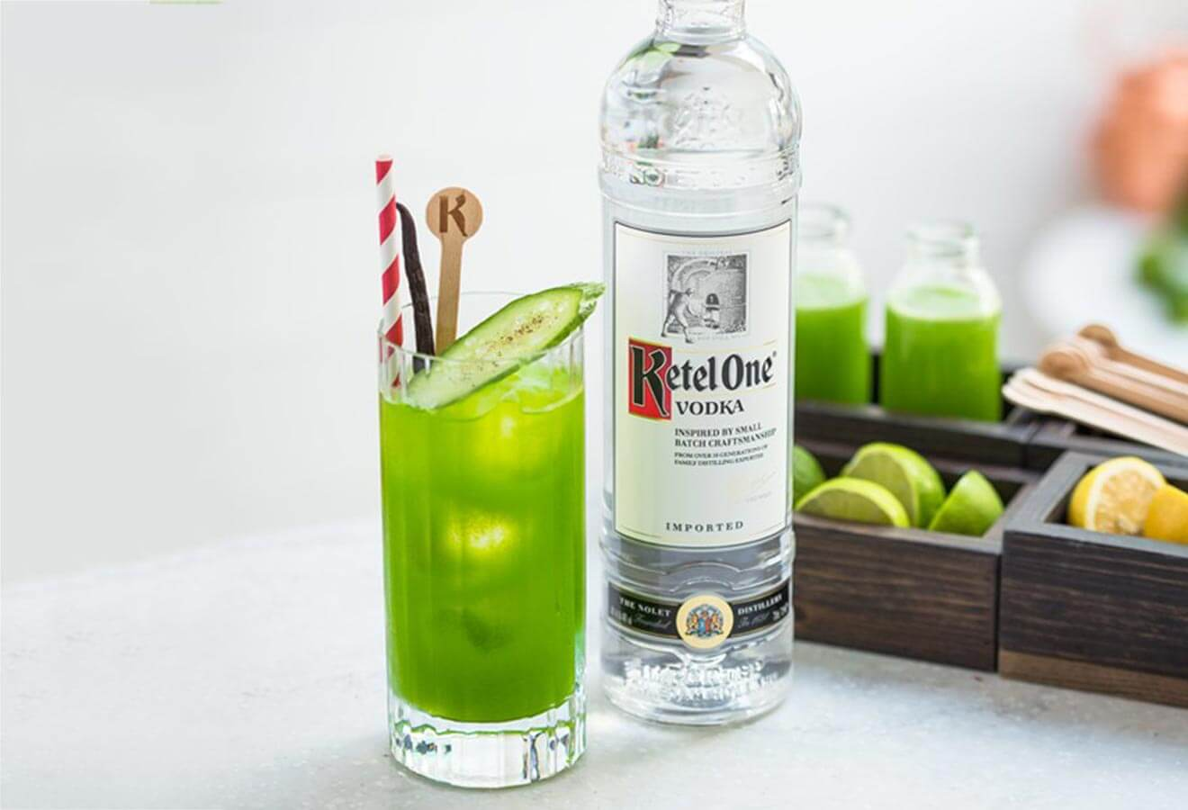 Ketel One Green Mary, cocktail with garnish, bottle, and fresh veg