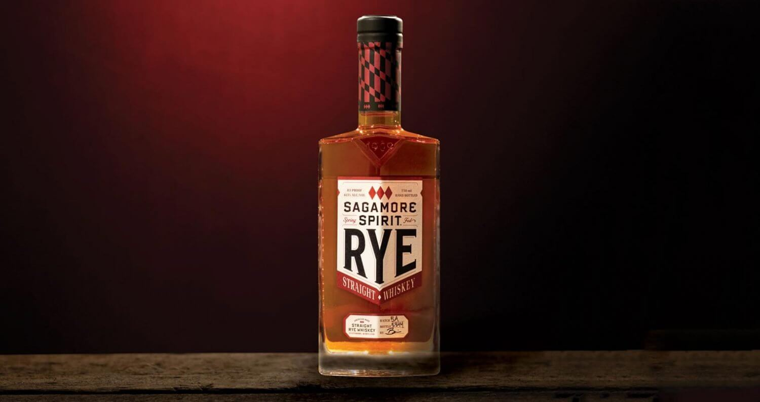 Sagamore Spirit Rye Whiskey, bottle on dark red back, featured image