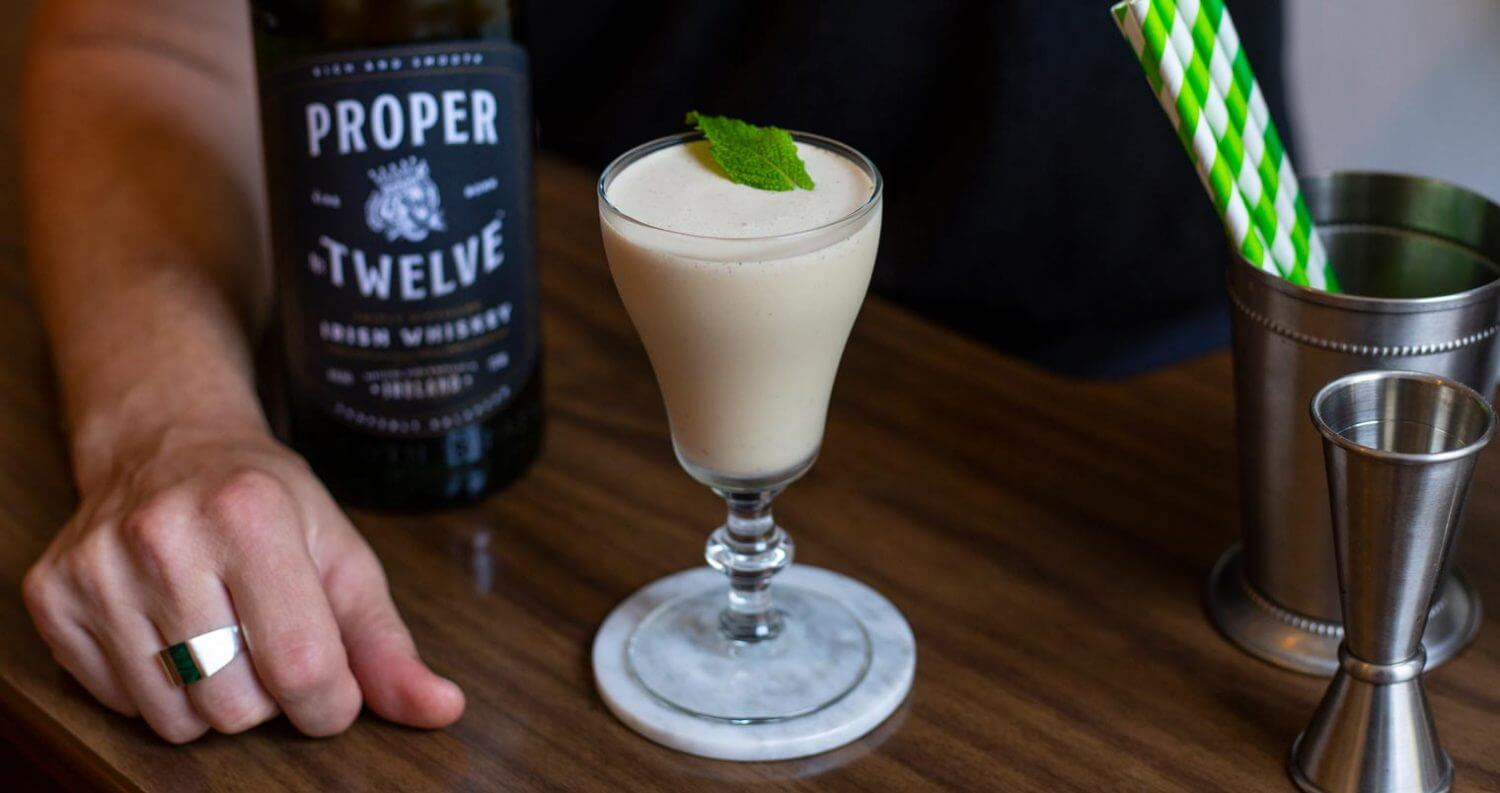 The Mad Mac, milkshake cocktail, bottle and green straws, featured image
