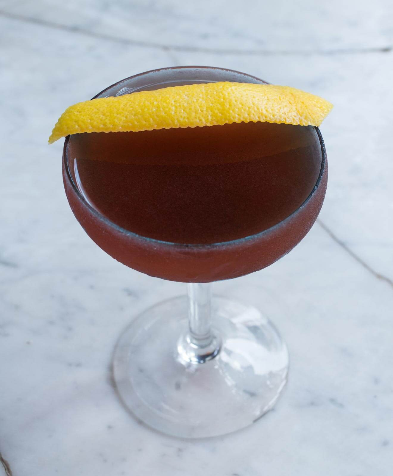 Trinidad Sour, cocktail with lemon peel garnish
