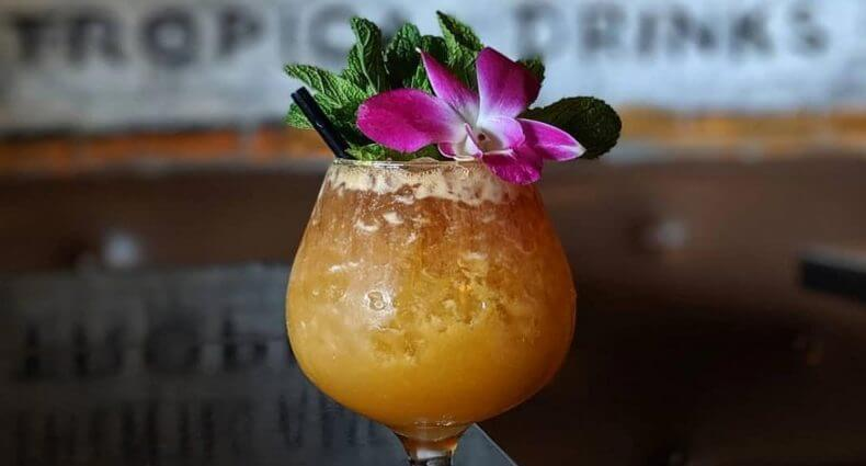 Peachy Texas Tiki, cocktail with garnish, featured image