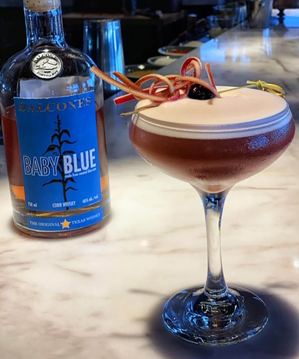 Rhubarbwire Blues winning cocktail with bottle and garnish