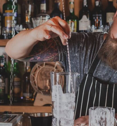 Personalizing Your Style, mixologist mixing behind the bar, featured image