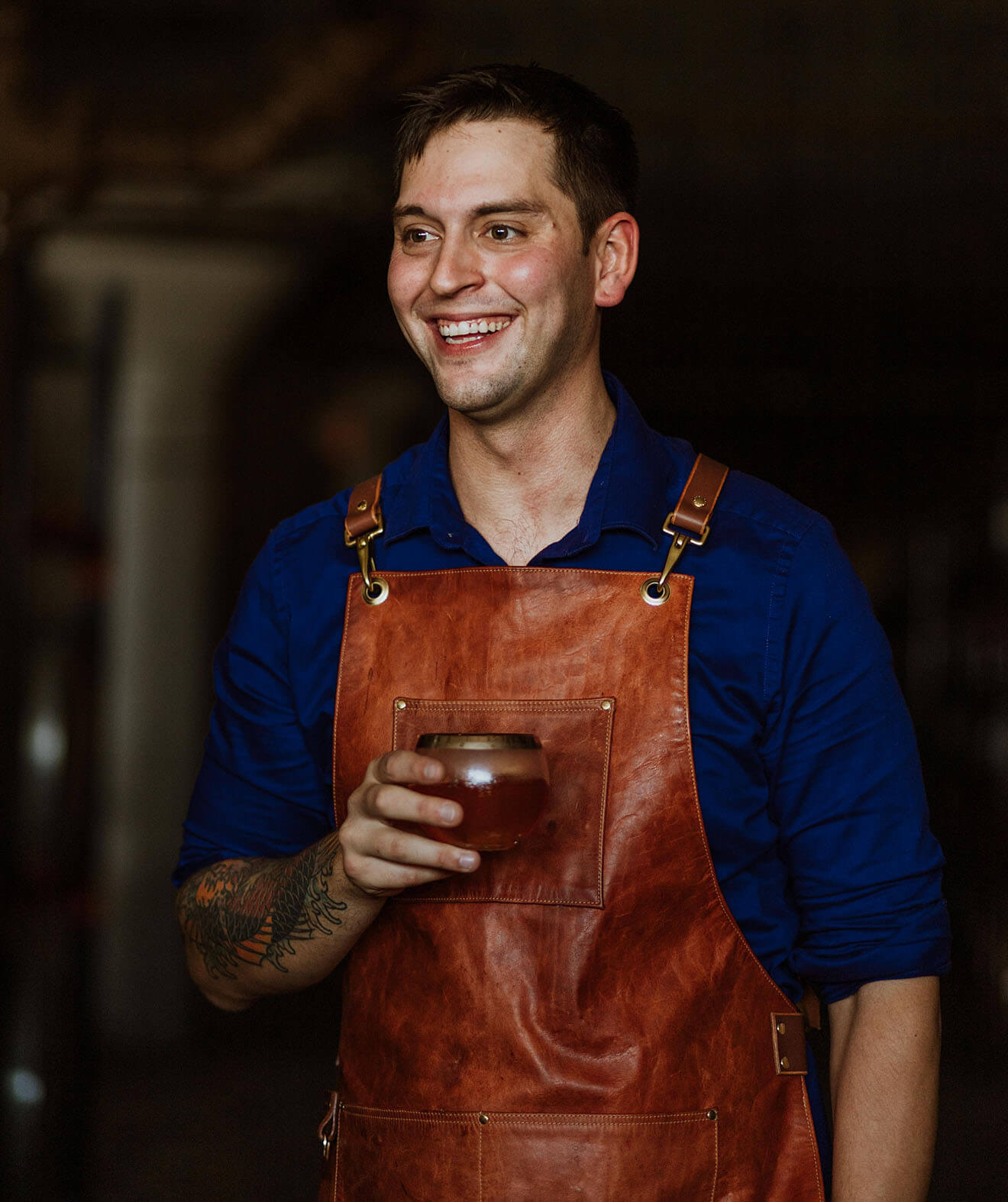 Marcelo Barredo, standing and smiling with winning cocktail