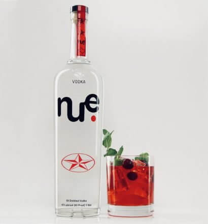Mistletoe Tonic, bottle and cocktail on white, featured image