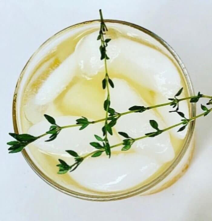 NUE Cider Thyme Tonic, cocktail, above shot, thyme garnish