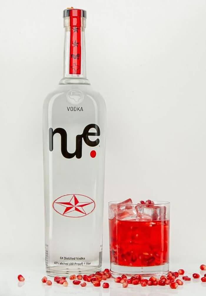 NUE Pomegranate Spritz, bottle and cocktail on white