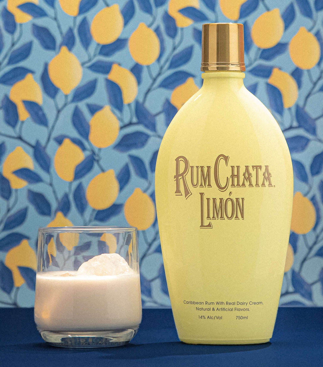 RumChata Limón on the rocks, bottle and cocktail, floral wallpaper