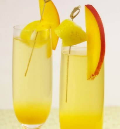 Peach Ginger Bellini, champagne cocktails, mango garnish, featured image