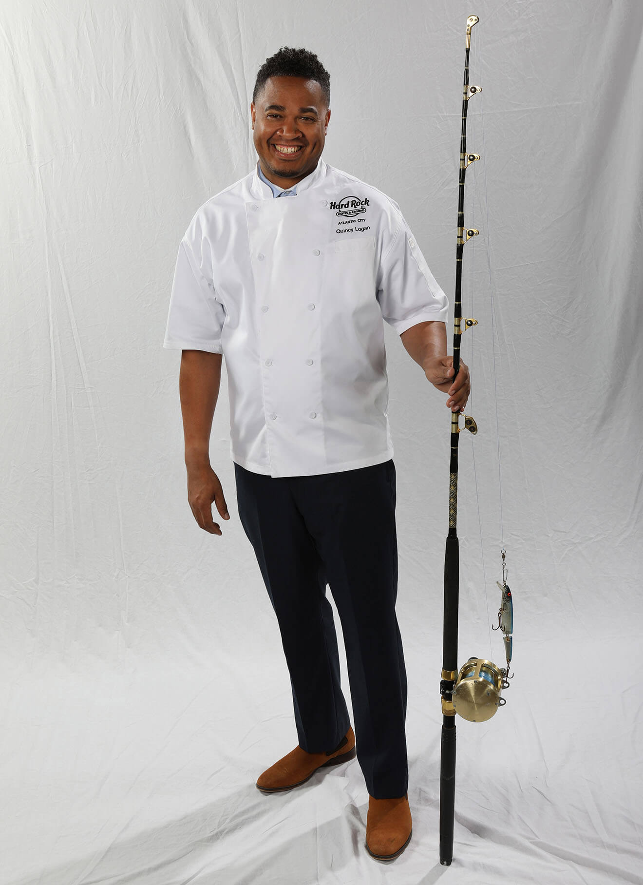 Chef Quincy Logan, fishing pole, light background