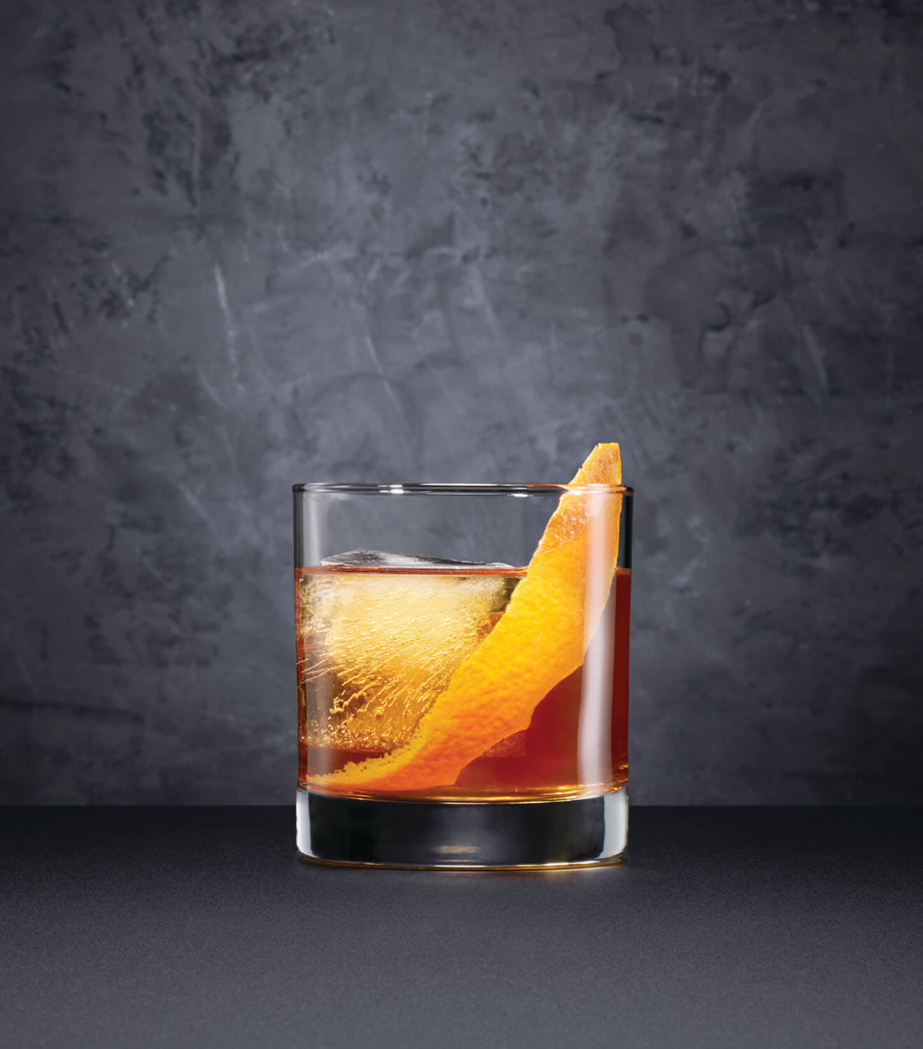 Black Barrel Old Fashioned, cocktail with garnish, dark grey background