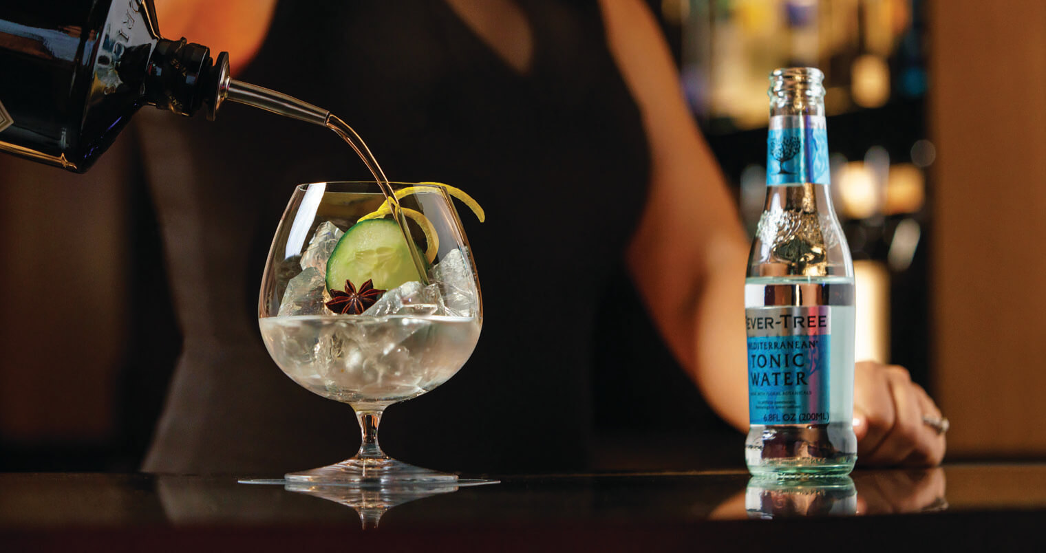 Signature Gin & Tonic Served at Castell Rooftop Lounge, featured image