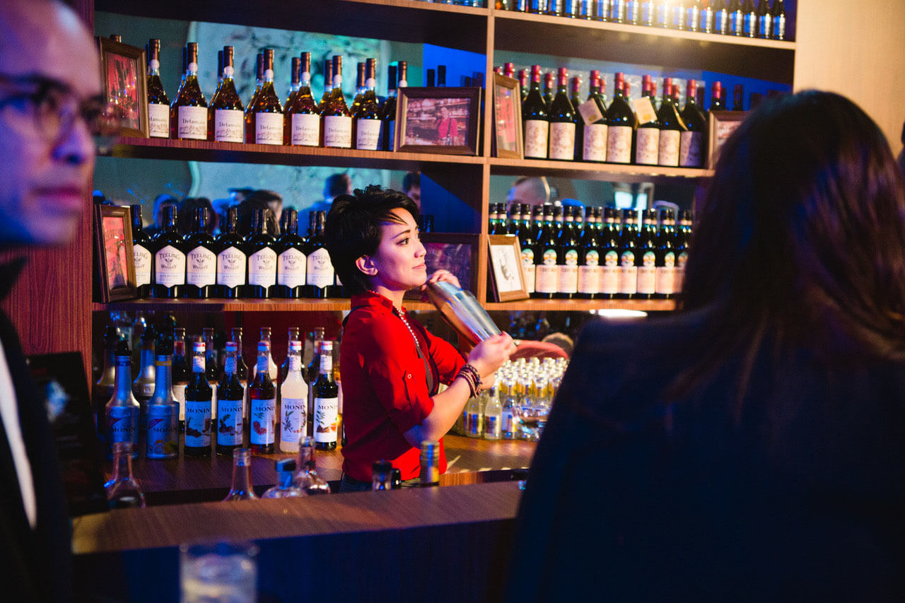 Meet Samantha Casuga</strong></h2> <em>CHILLED 100 Member, New York, shaking up a cocktail behind the bar