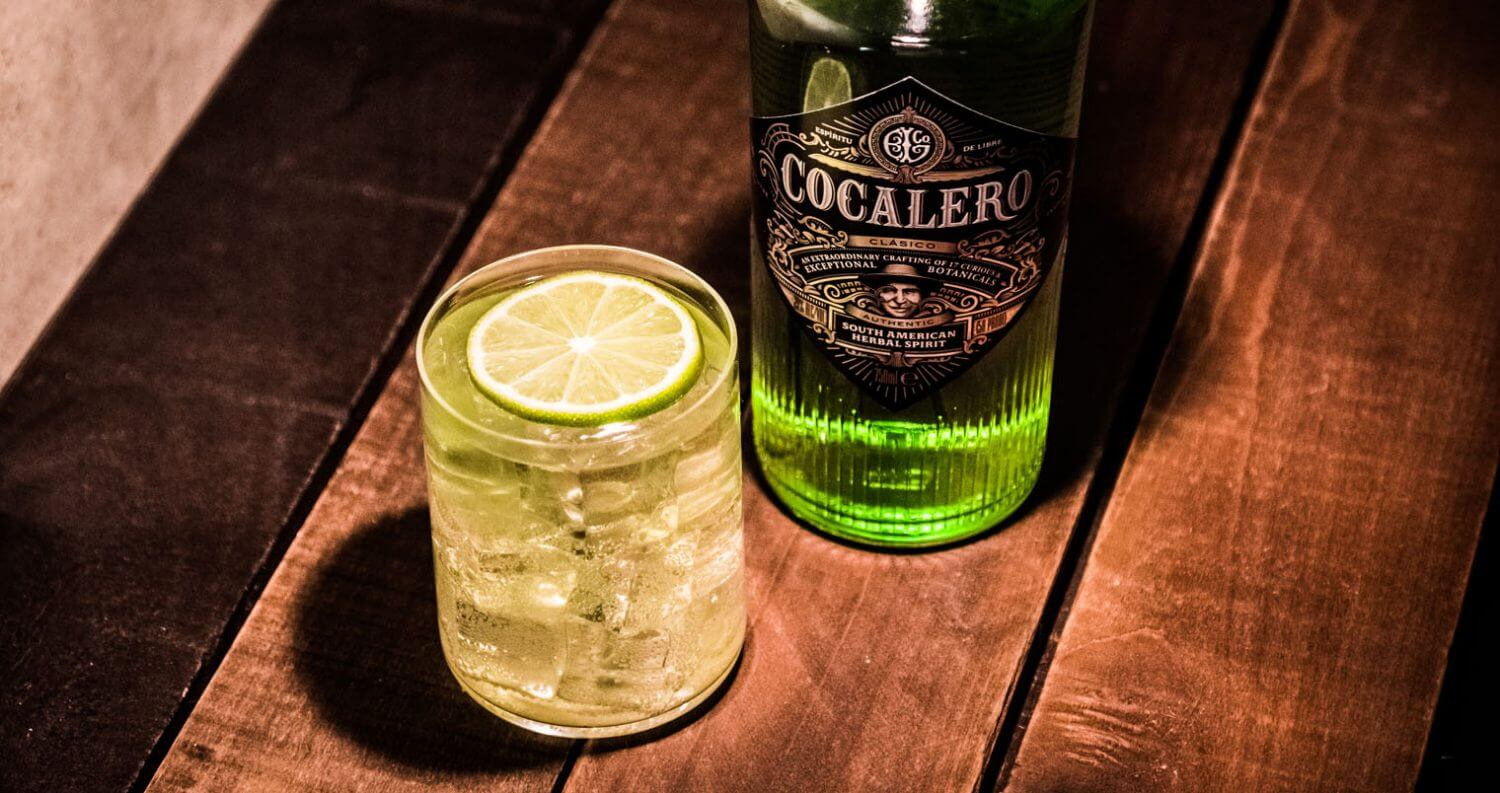 Cocalero Cocktail, wood table, featured image