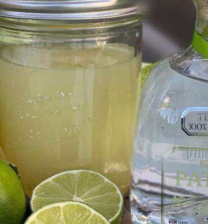Honey Salt Cocktails on the Go, cocktail and patron bottle, limes, featured image
