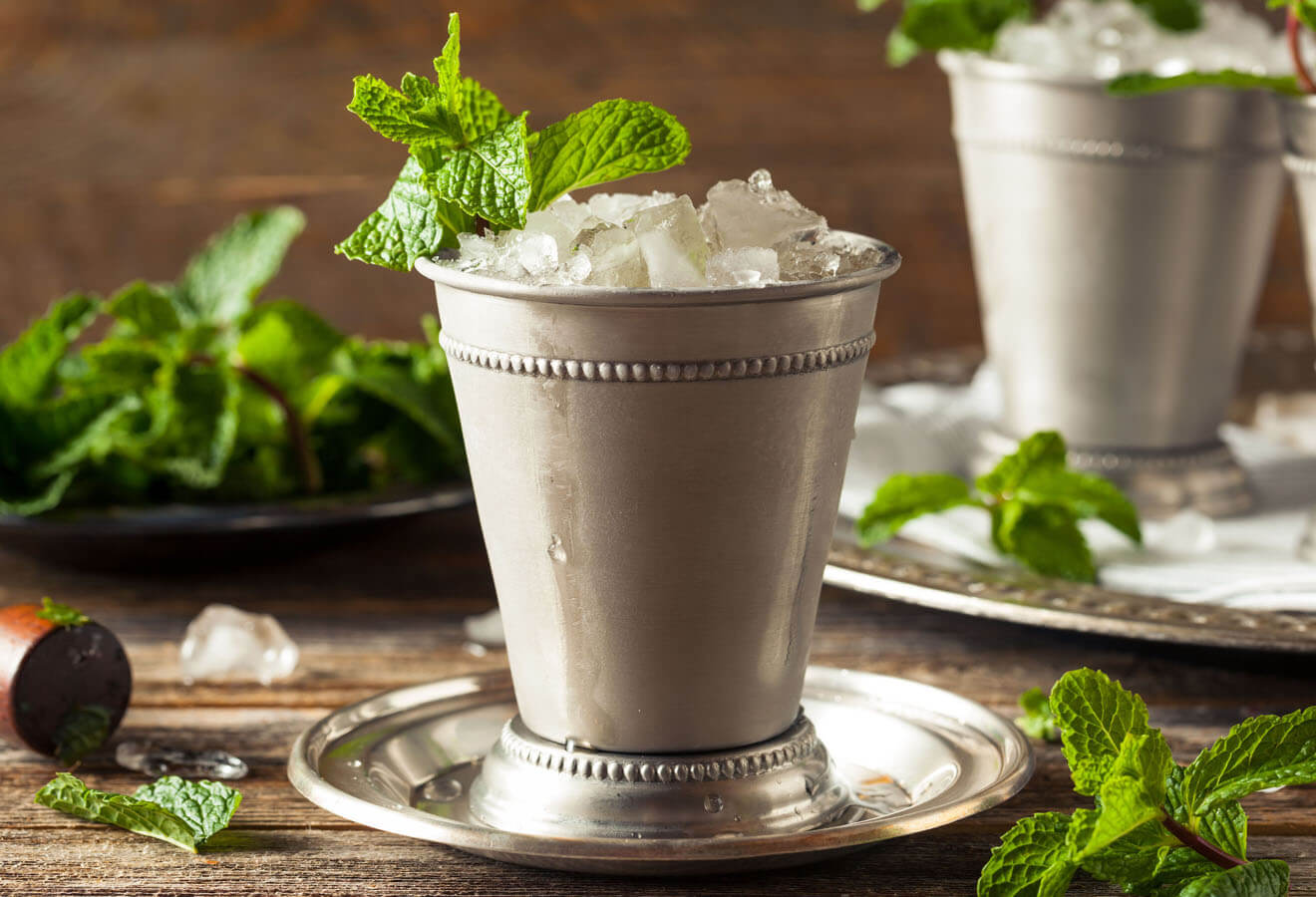 Mint Julep, classic cocktail in metal glass, mint garnish