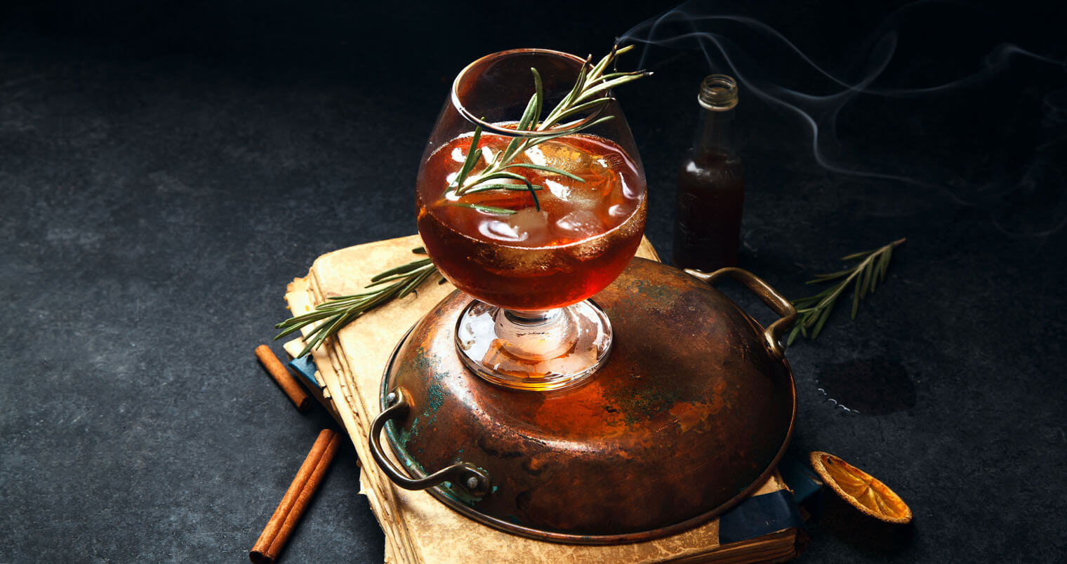 Mixing with Rosemary, cocktail with herb garnish, featured image
