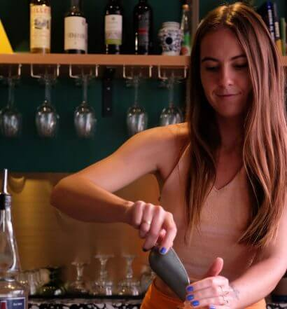 Veronica Slabicki, mixing behind the bar, featured image
