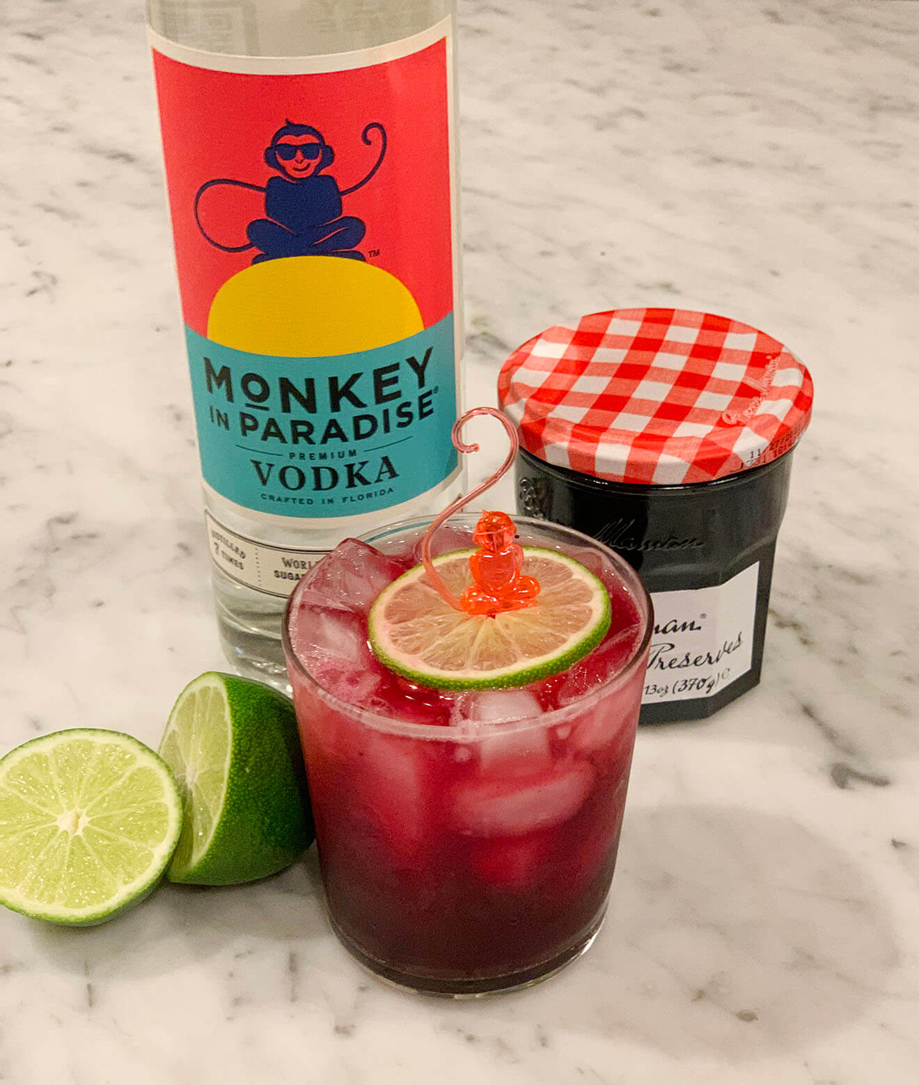 The Monkey Jam, limes, monkey bottle and straberry jam