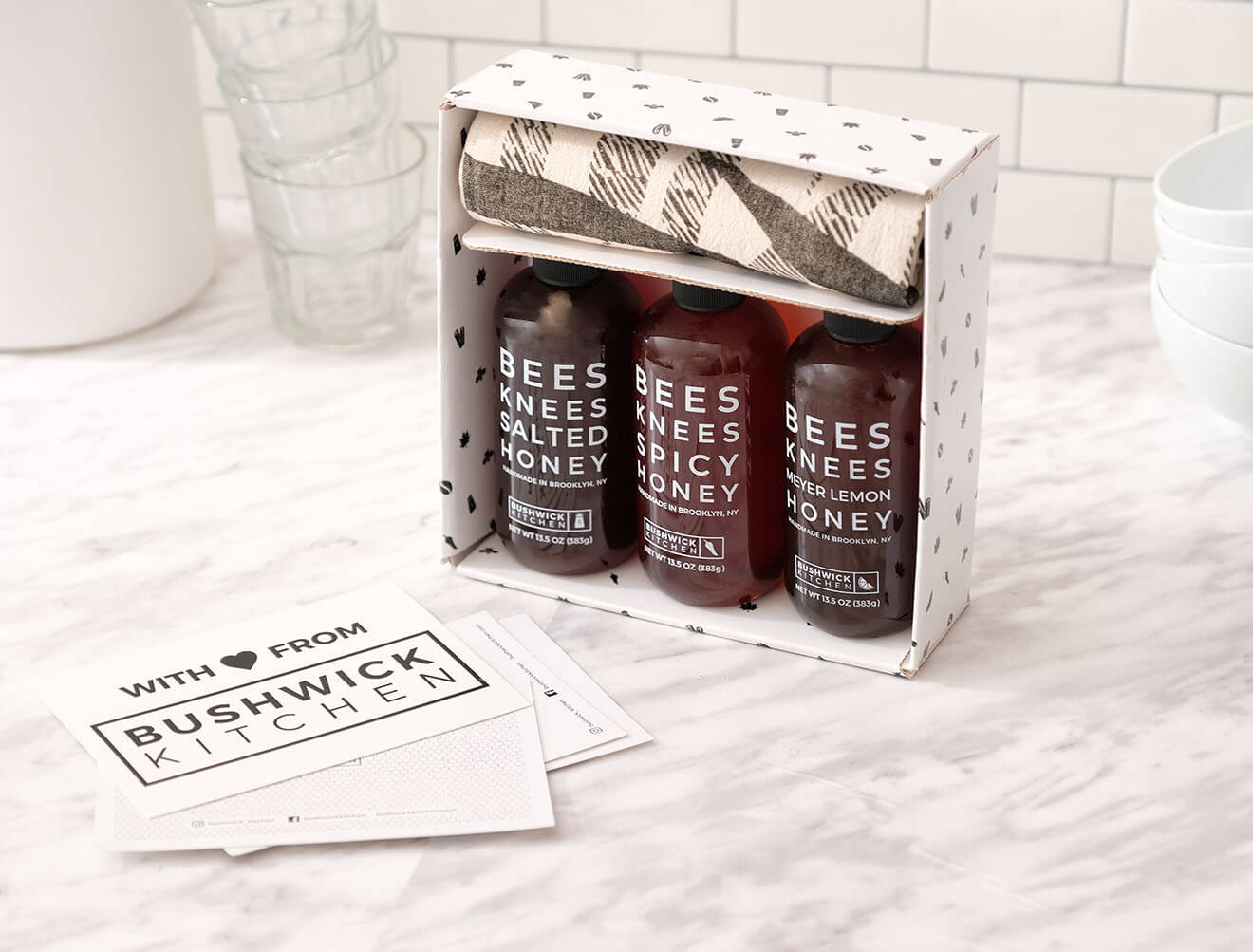 Bushwick Kitchen Condiments, packaging and bottles on marble