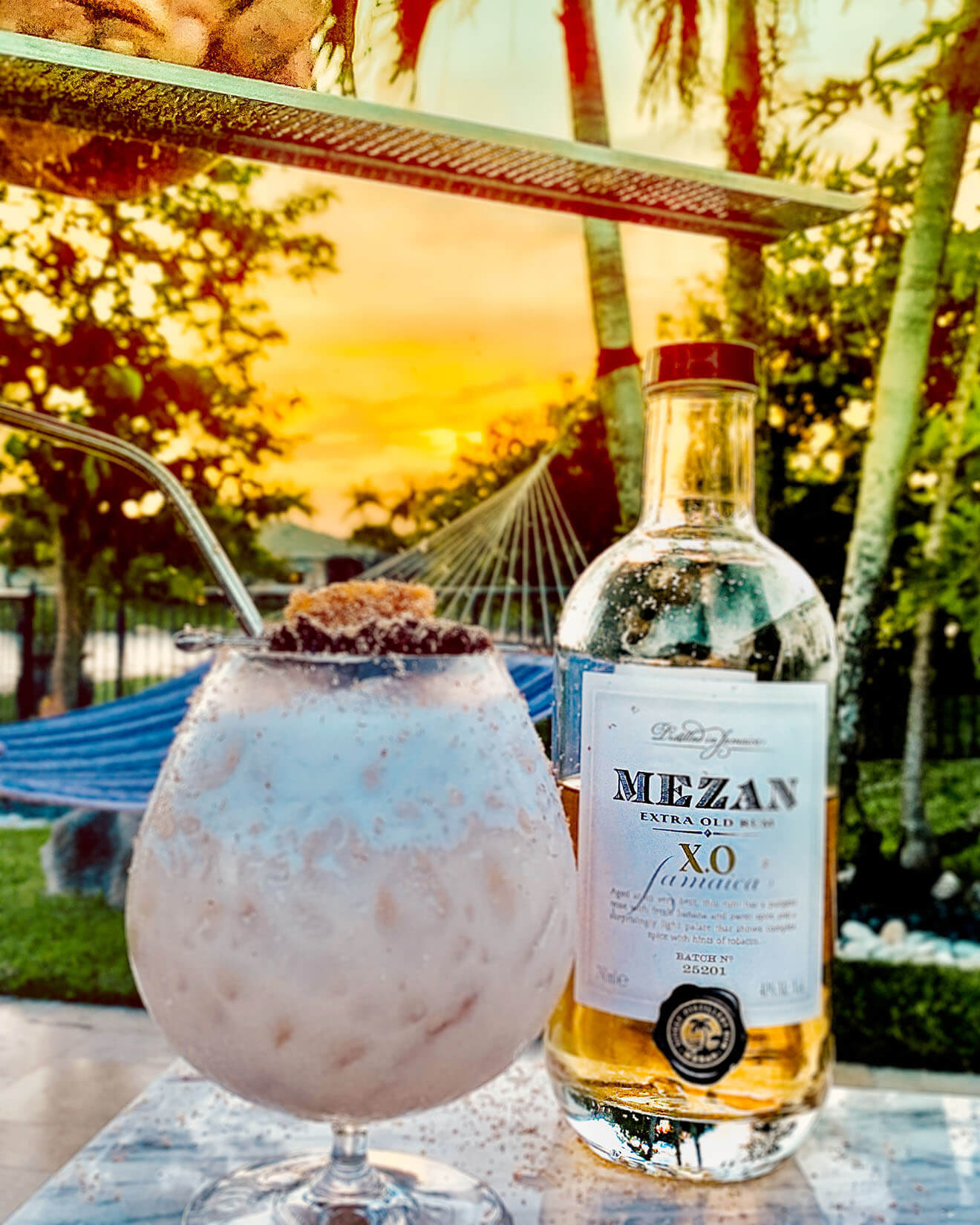 R & R, cocktail and mexan xo rum bottle, tropical background