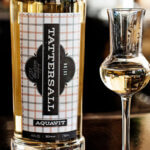 Tattersall Aquavit, bottle and glass on bar, featured image