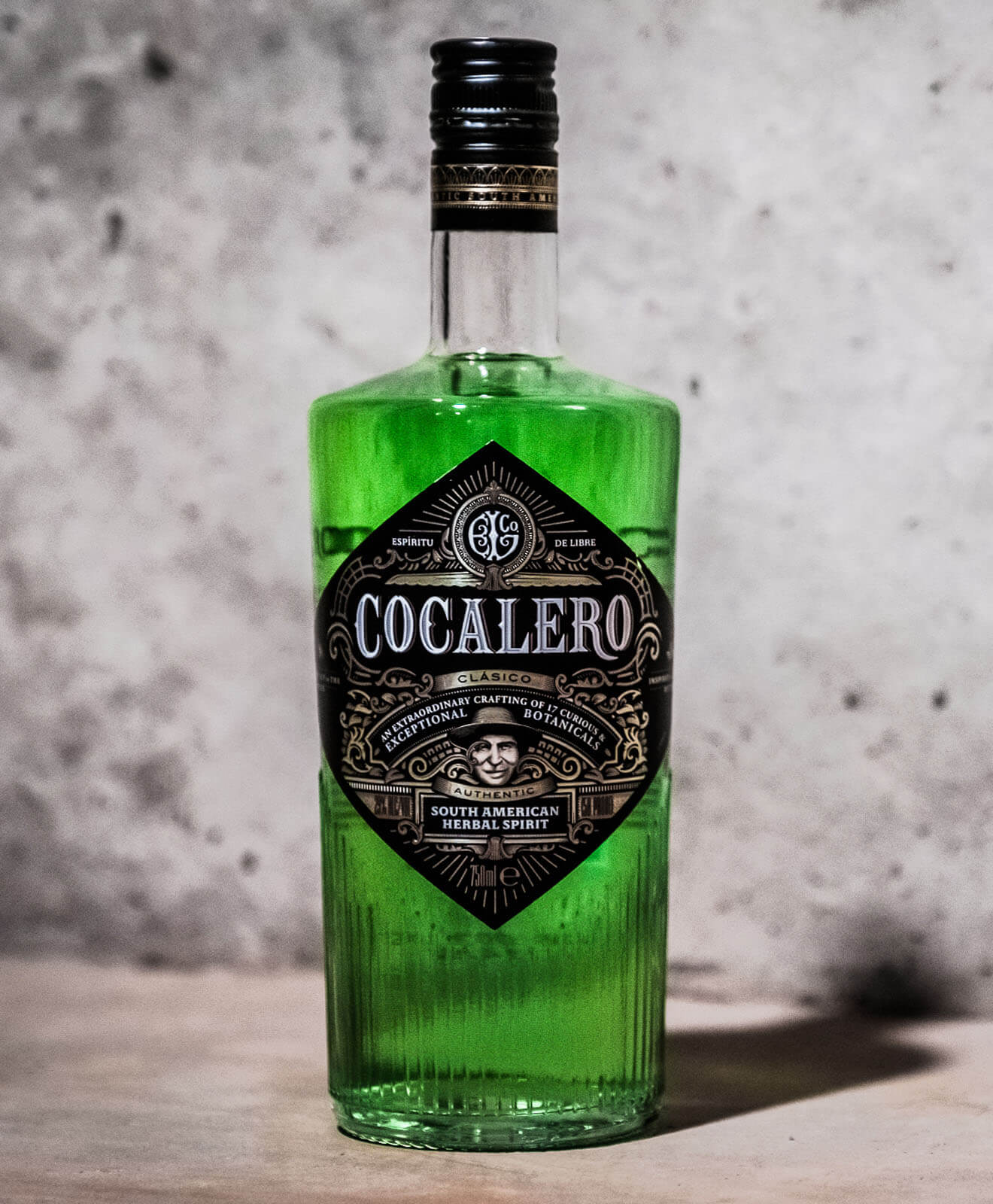 Cocalero Clásico, bottle on marble background