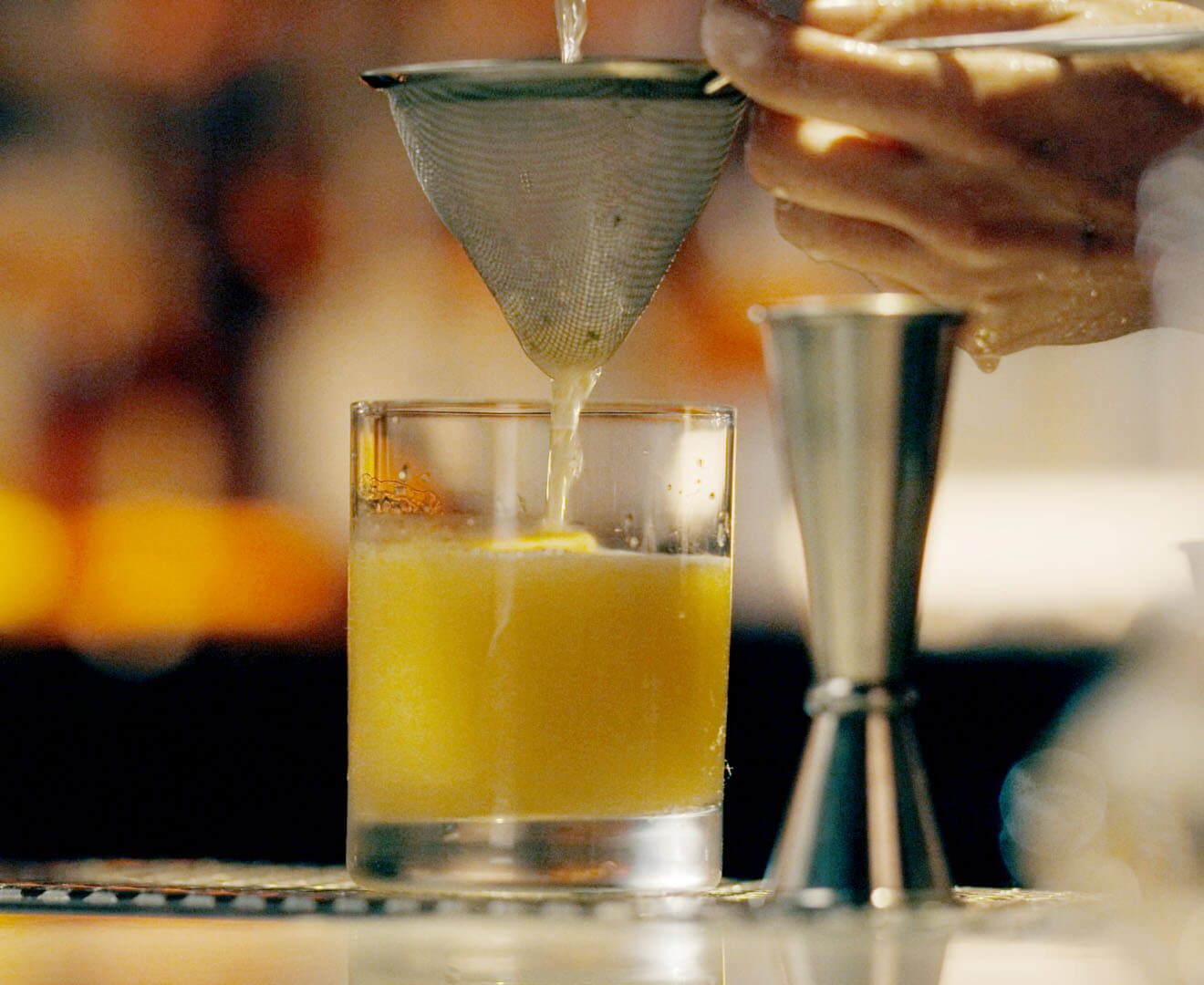 Bartender mixes drinks at New York's Death & Co