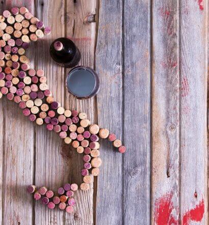 Get to Know Italian Wines, featured image, corks in shape of italy, painted wooden deck