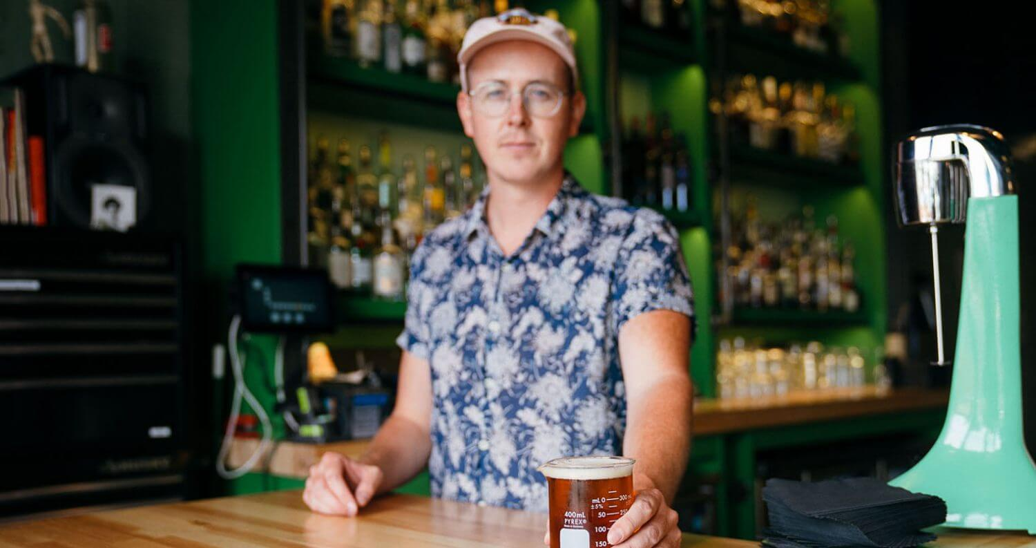 Scott Gardner of Water Witch, behind bar, featured image