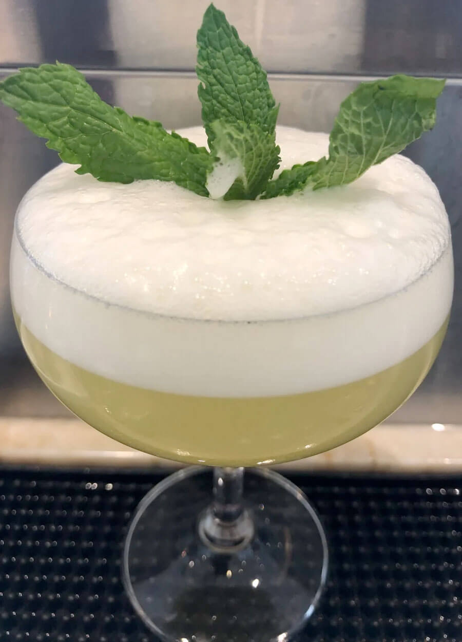 Starry Night, cocktail with herb garnish