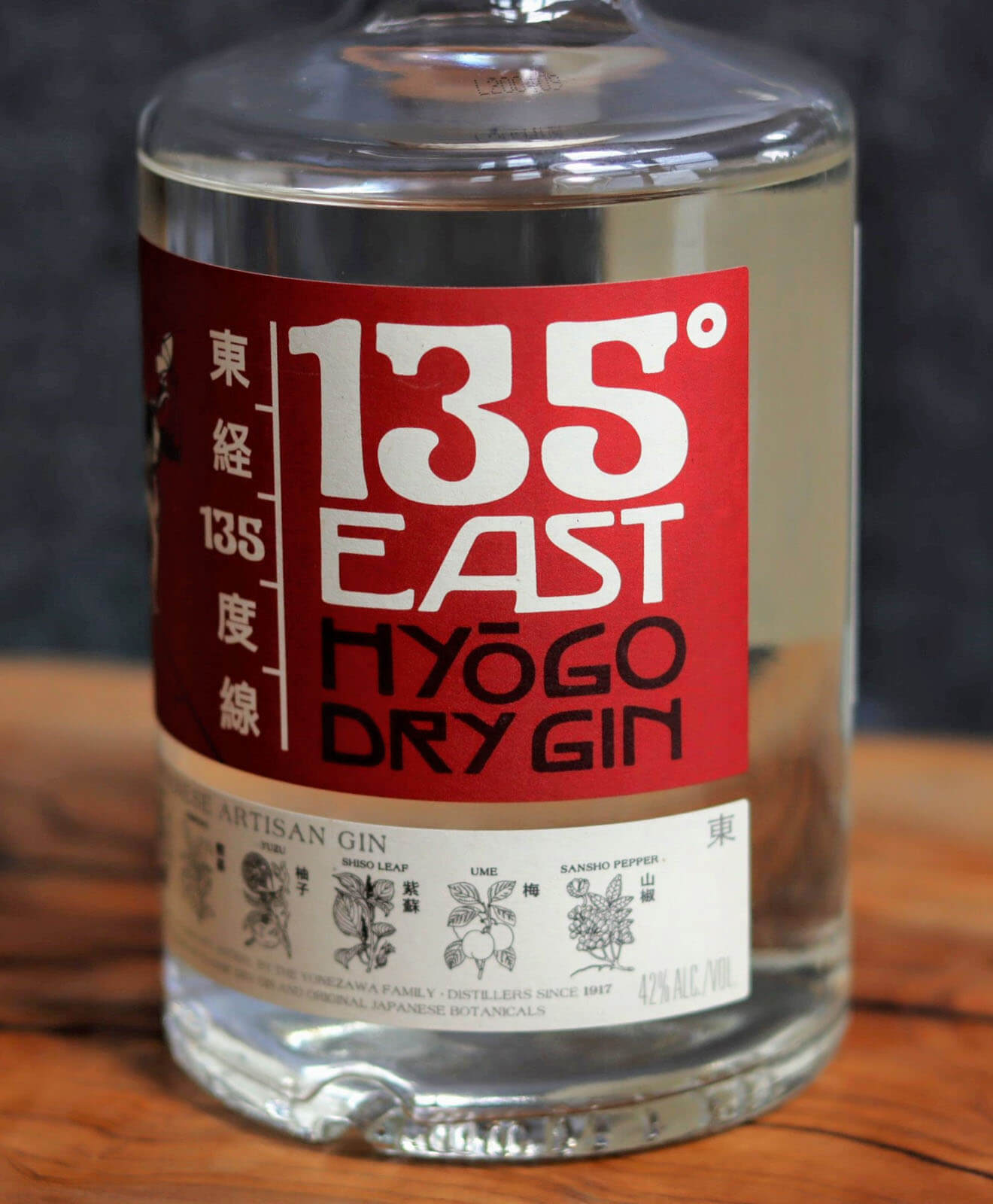 135 East Ginm bottle on table