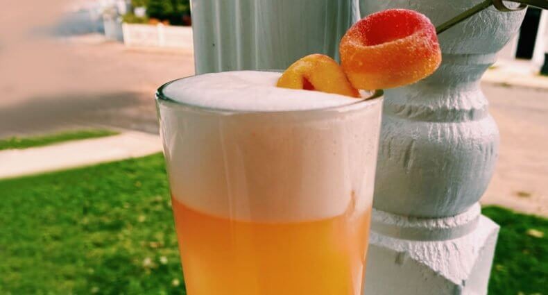 I Like Your Peach Fizz, cocktail with garnish, featured image