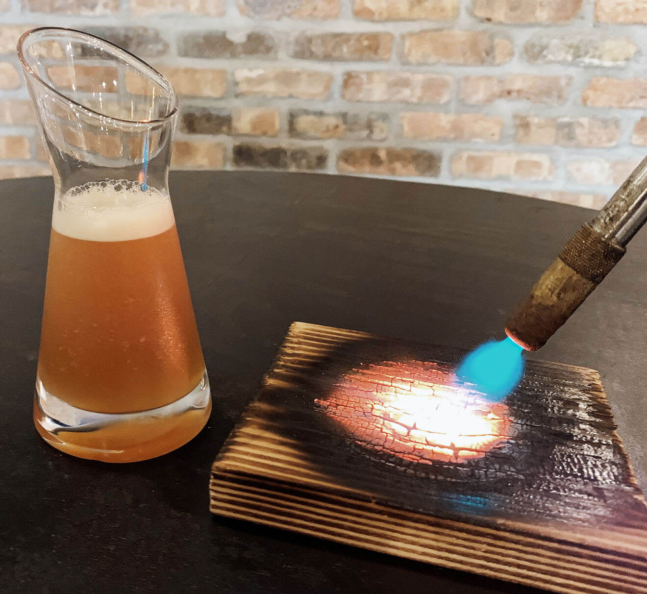 Smoke and Cure cocktail and pine plank torched
