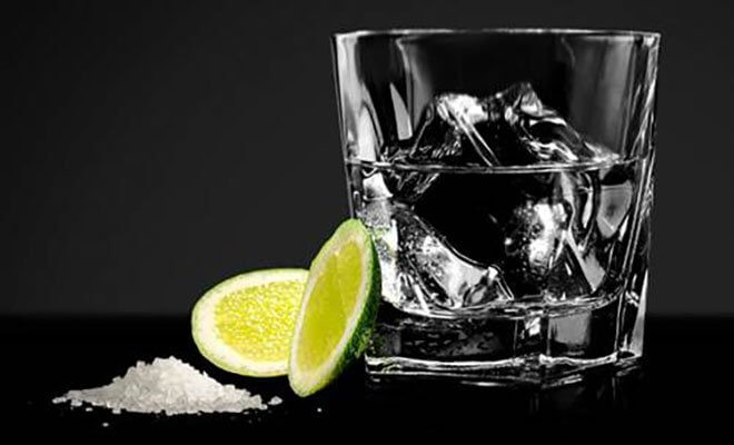 The Ritual cocktail with limes and salt, dark background