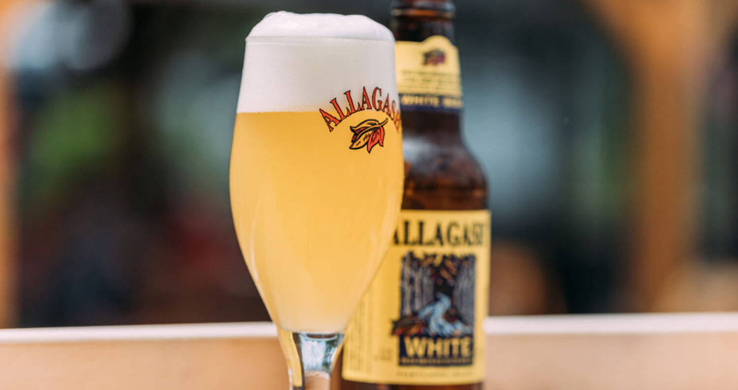 Allagash White, glass and bottle on wood table, featured image