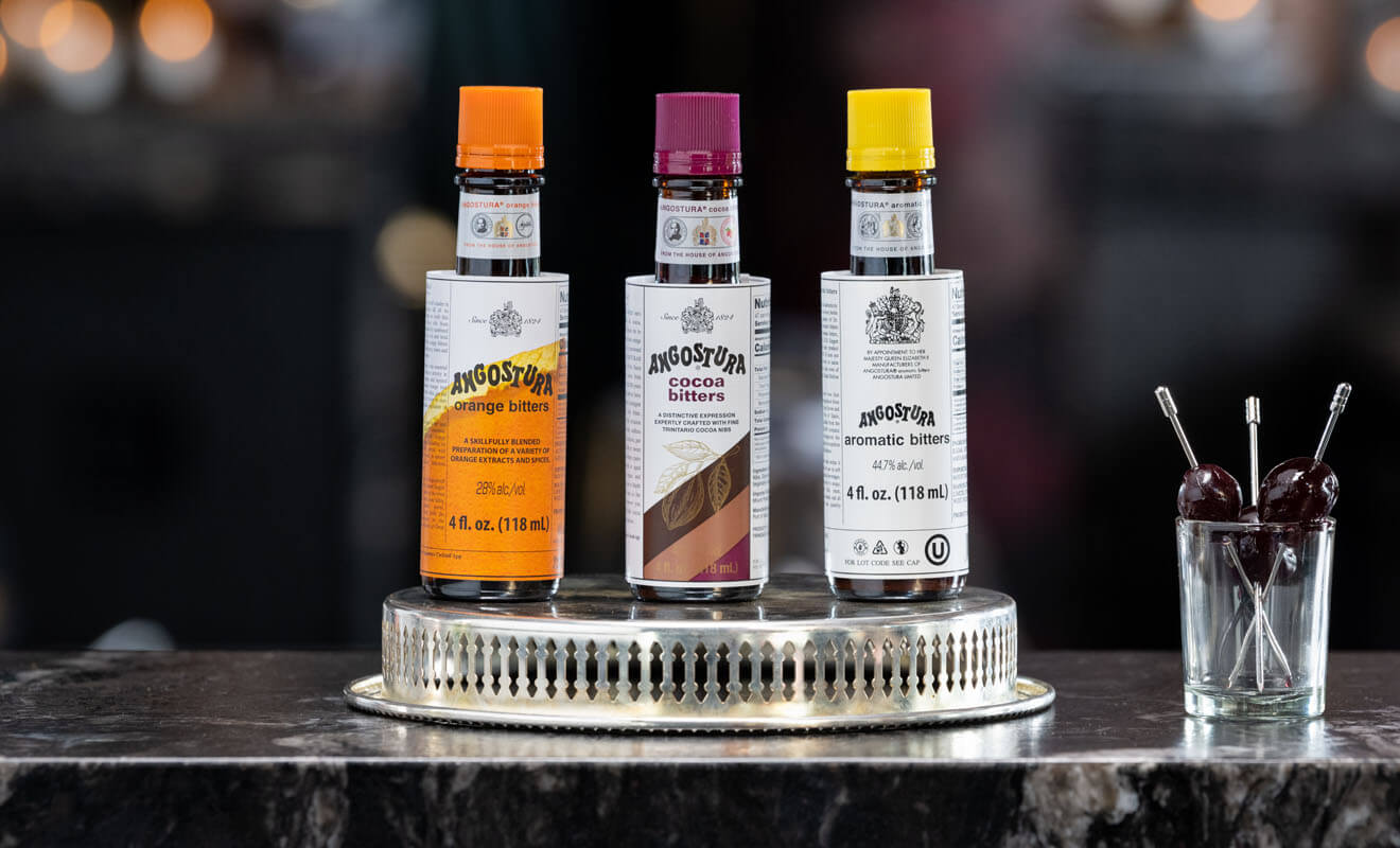 Angostura's Bitters Lineup, bottles on silver tray, bar tools