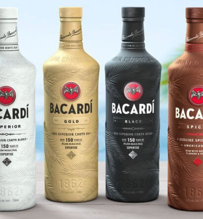 Bacardi Innovative Paper Bottles Lineup, bottles on bar, tropical beach, featured image