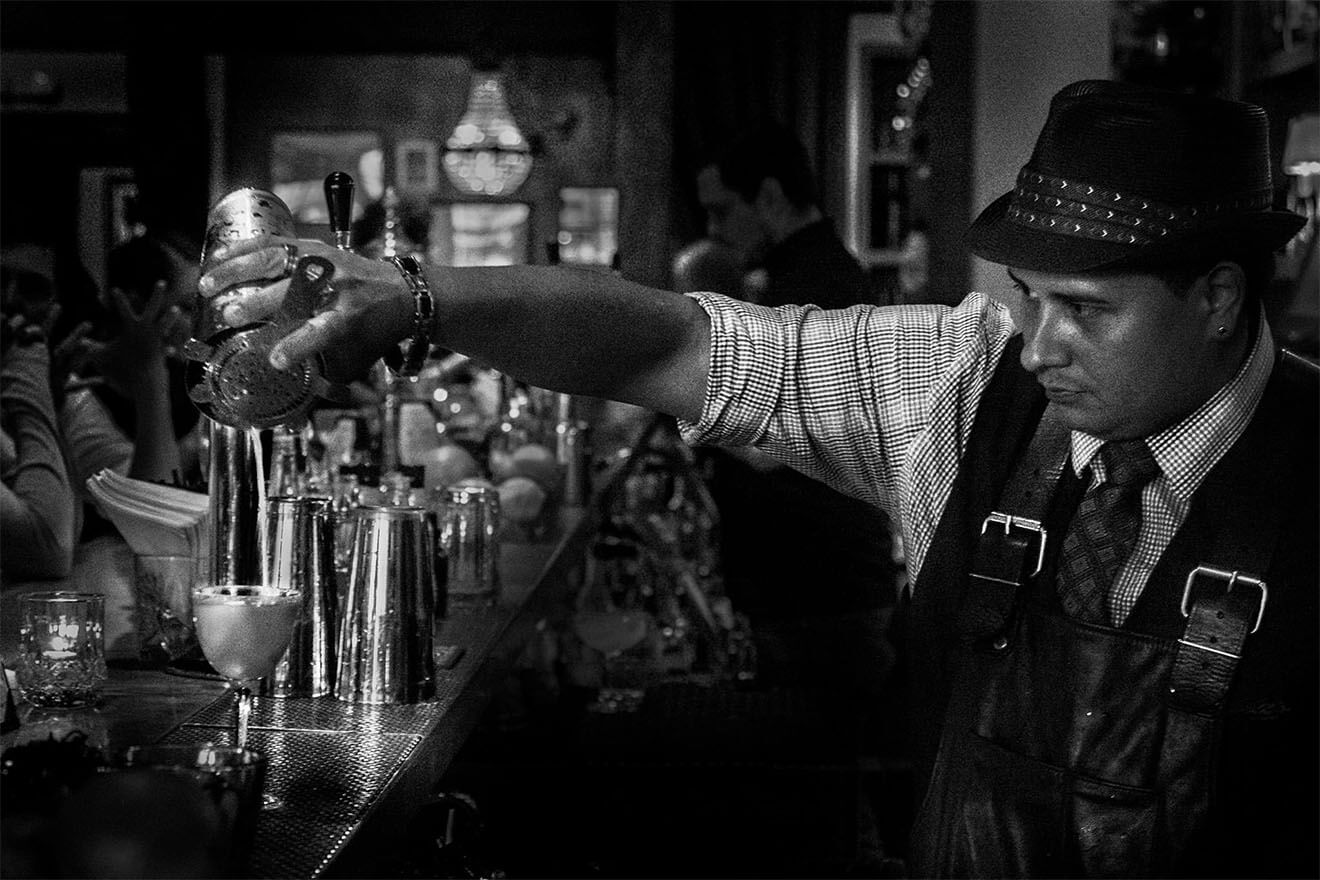 Alex Velez - Chilled 100 Member, San Francisco, mixing behind the bar, black and white