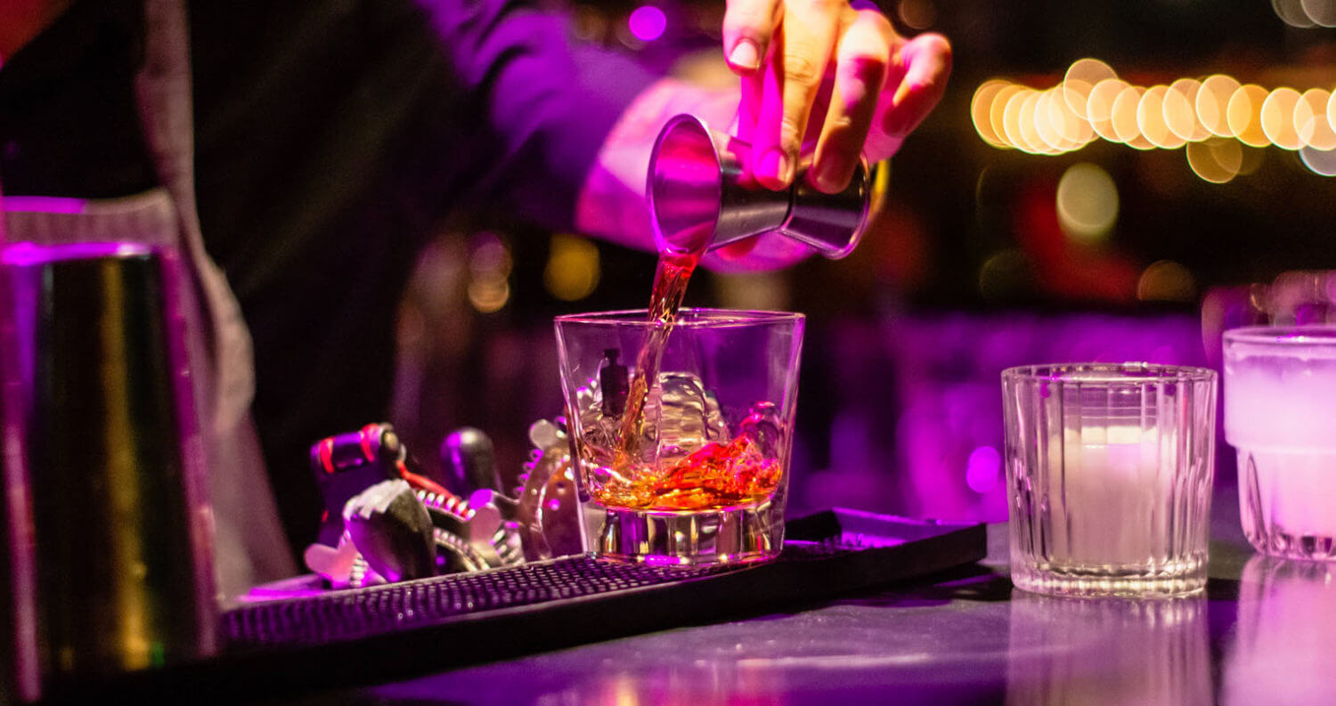 Bartender mixing a drink, featured image