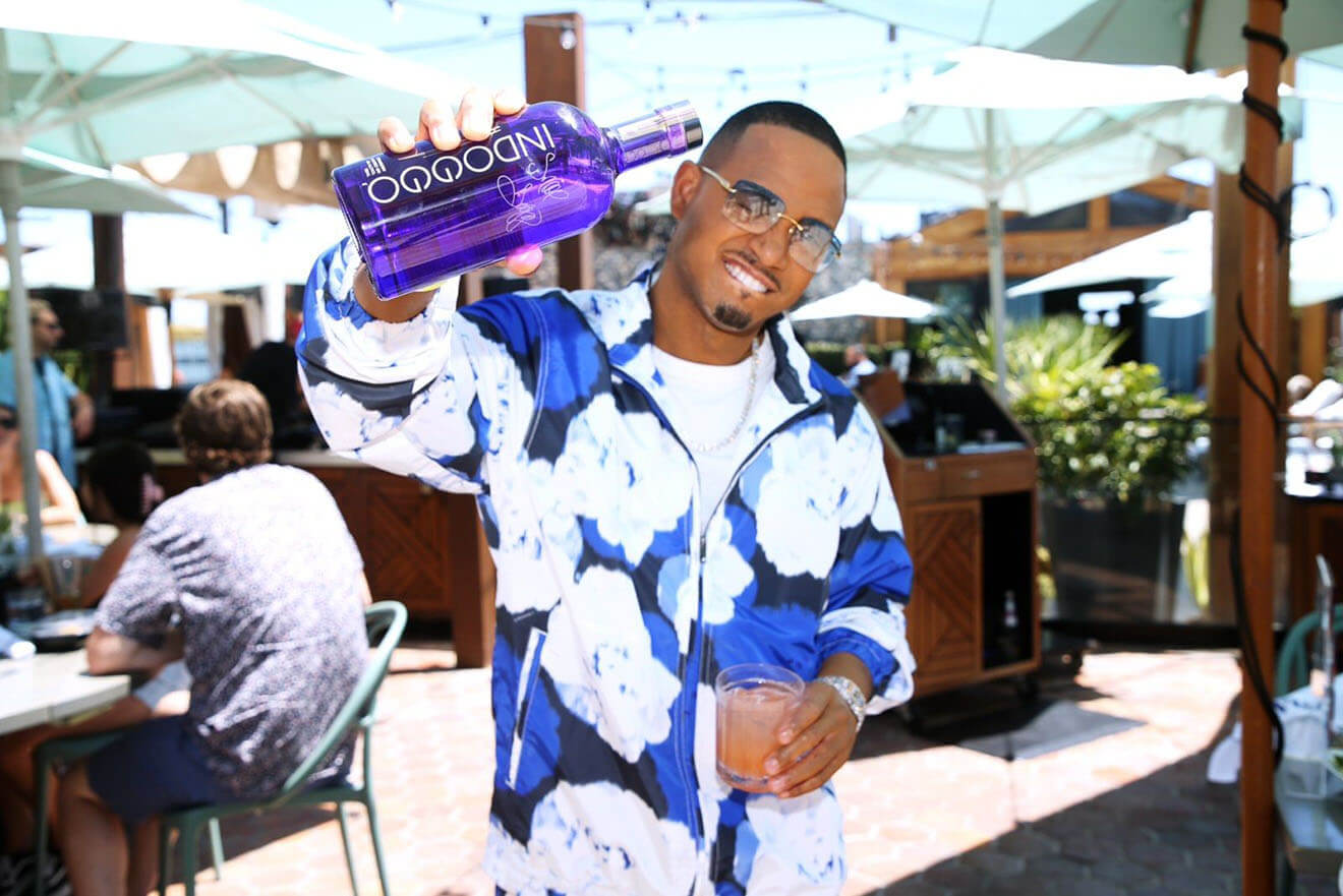 Terrence J Shows Off a Bottle of his Favorite Gin, INDOGGO® as he Celebrates World Gin Day at for an Exclusive INDOGGO® takeover at the Highlight Room