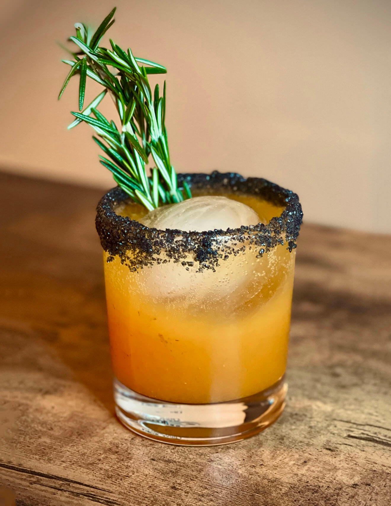 """""""Goblet of Fire"""" cocktail with garnish"""